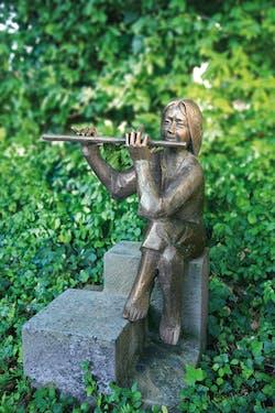 Bronzefigur Flötenspieler von Theophil Steinbrenner