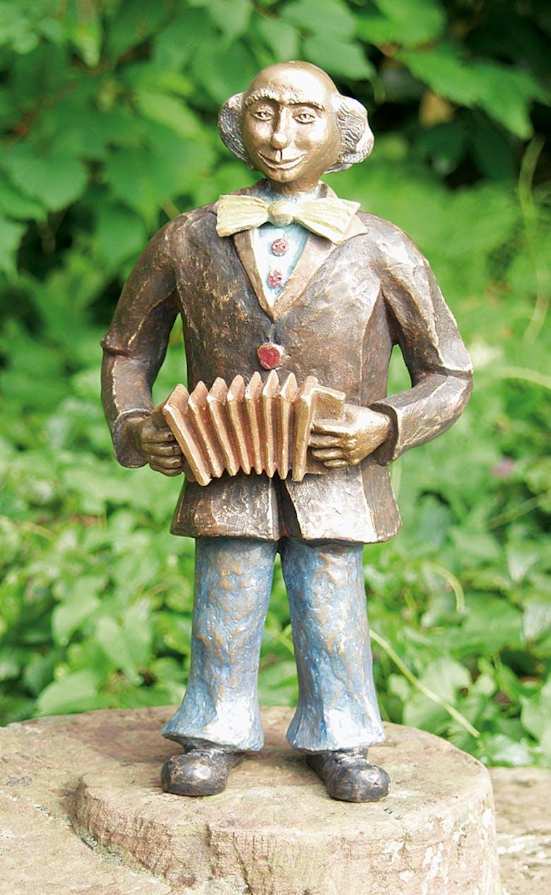Bronzefigur Clown mit Harmonika von Kurt u. Bruno Eggenberger
